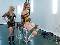 Aiden Starr ties up Claire Robbins in bizarre getup and then fucks her clit with a toy