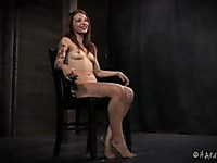 Alyssa Branch is a cute redhead and she is enduring some very bizarre bondage action