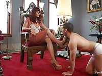 Redhead milf Maitresse Madeline shows a young dude what foot fetish is all about