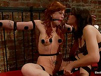 Brooklyn Lee is in bondage on her bed and Bobbi Starr is zapping her with bizarre contraption