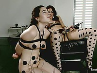 Bobbi Starr makes her bondage slut Nadine Sage lick her pussy as she gets zapped