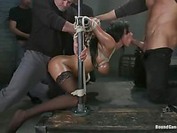 Curvy girl Anissa Kate is in bondage and getting smashed by a throng of enormous wangs