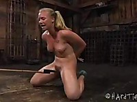 Tracey Sweet is a sexy blonde in bondage, with her ass glowing red and her snatch toyed