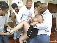 Slutty milf Ava Devine gets fucked hard by two big black cocks at the same time and she loves it