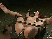 Busty redhead Kelly Divine with huge tits gets tied up and fucked hard by her master.