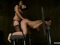 Amber Rayne gets her head and arms through the pillory while her ass is spanked and fucked.