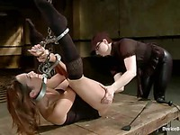 Babe Amber Rayne gets tied up on a table and her lips stretched forcefully.