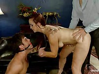 Horny stud is used like a bitch by Bella Rossi's master who fucks her too.