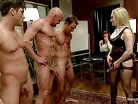 Hot porn star Aiden Starr enjoys spanking her three hunks and making them suck each other.