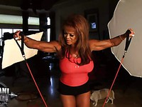 Sexy ebony milf DD Aziani shows off her rounded melons and tense muscled arms.