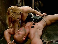 Milf Lea Lexus wearing slutty fishnets puts a gas mask on her servant and ties his dick with a rope