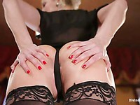 Hot close-up shots of Ashley Fires's perfect legs in black stockings and rounded bum.