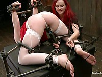 Jodie Taylor's asshole and pussy are fucked hard by Keara Black in a teardrop hogtie position.