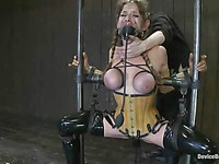 Horny slut Felony is restrained on a sex machine and she loves having the hook in her ass.