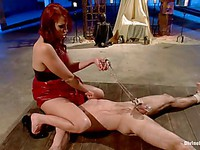 Hot mistress Nikki Hunter teaches her male servant how to lick her feet and wet shaved cunt.