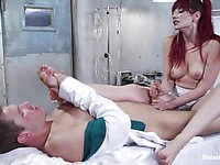 Redhead Maitresse Madeline stuffs her toes into the guy's mouth and fucks him mercilessly.