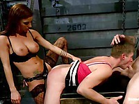 Bombshell Gia DiMarco in black stockings pinches her slave's nipples and stimulates his hard dick