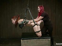 Slutty Romona Vaine and Tricia Oaks are hanging hogtied while their nipples are teased with clasps.