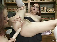 Nerdy Penny Pax with huge milky tits sticks a long stick into Kristina Rose's sweet ass.
