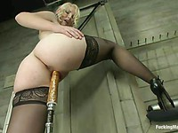 Sexy blonde Ella Nova cums hard after the sex machine with a big dildo fucks her cunt properly.