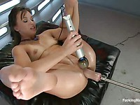 Pretty brunette Alisa Gap spreads her legs so the fucking machine can fuck her deeper and harder.