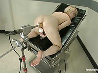 Ash Hollywood spreads her legs on a gynecological chair and strokes her dripping cunt and ass.