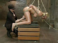 Hogtied Katie Summers gets her lips and nipples pinched and her tight asshole hooked.