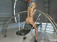 Nicole Graves's oily rounded boobs shake as she rides the fucking machine eagerly like a slut.