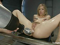 Chastity Lynn's small hard pink nipples are clasped while she drills her dripping pussy.