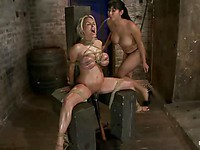 Old Holly Halston is tied to the chair while younger Isis Love whips her and slaps her like a slut