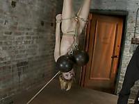 Petite blonde Emma Haize loves to hang upside down while her small boobs are slapped and teased.