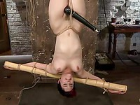 Emo babe Iona Grace with amazing curves is hanging upside down while her wet cunt is stimulated.