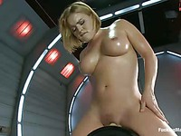 Busty blonde Krissy Lynn strokes her big melons as the machine drills her wet soft hole.