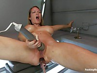 Hot chick Rain DeGrey stimulates her throbbing clit with a vibrator as the machine fucks her.