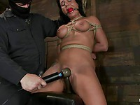 Gagged brunette Mahina Zaltana gets gagged and her big delicious tits get pinched and groped.