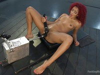 Daisy Ducati stripping and getting her fetish loving slit filled with a plastic cock on a machine.