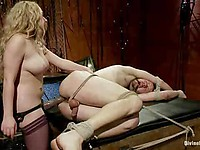 Blonde Aiden Starr blindfolds and gags a femdom lover and humiliates him during kinky bondage.