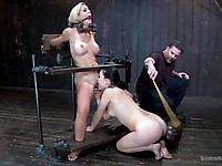 Gagged bondage babe Cherie DeVille put into stocks and has her shaved slit vibrated and teased.
