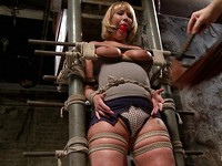 Mellanie Monroe passionately wiggling her body while getting stimulated and kneaded in bondage.