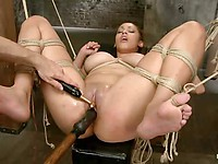 Serena Ali gagged and in ripped clothes while her slit is vibrated and drilled with bondage toys.