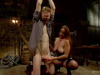 Bella Rossi ties up her slave and drilling and stimulating his body during femdom.
