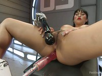 Mia Li on her knees getting her shaved fetish holes rammed and filled put with a sex machine.