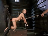 Amanda Tate is stripped down and getting into hardcore bondage after she is tied with ropes.
