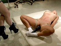 After getting Milcah Halili tied up bondage lover Aiden Starr uses a speculum on the Asian's ass.