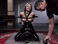 Dani Daniels has her massive tits teased and pinched while dressed in all black during bondage.