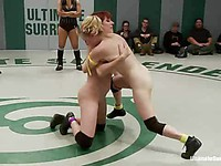 While in naughty cat fights Penny Pax ends up on the floor tangled between her opponents legs.