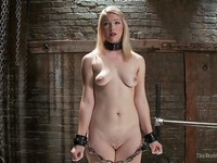 Ella Nova in a tough position while her pale body is teased and stimulated hard in rough sex.