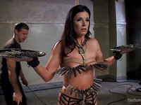 India Summer is moaning and heavily catching her breath while she is tied up and enduring spanking.