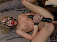 Dakota Skye is getting her tight body gagged and teased with a vibrator before rough sex.