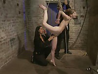 Sensi Pearl has her hands tied behind while the gorgeous bondage babe Isis Love stimulates her.